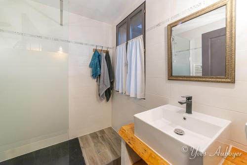 La salle de bain et sa douche à l'italienne
